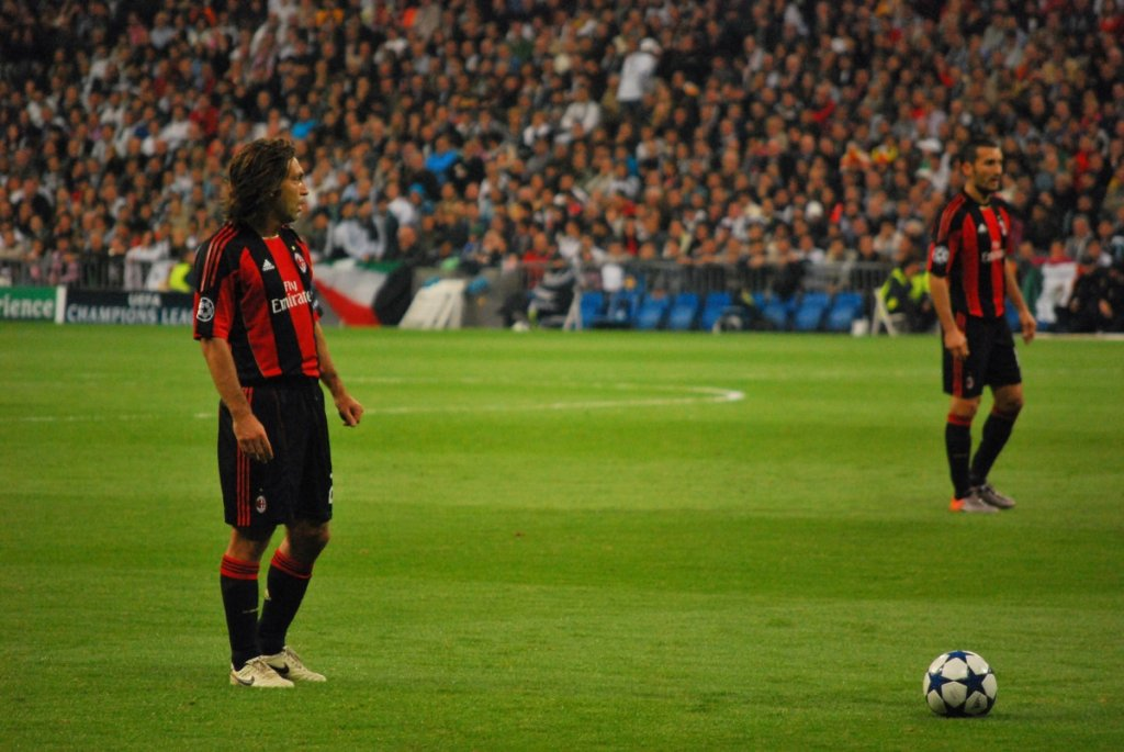 Pirlo (left), with Milan, preparing to take a free kick against Real Madrid in the 2010–11 UEFA Champions League. &copy Jan S0L0